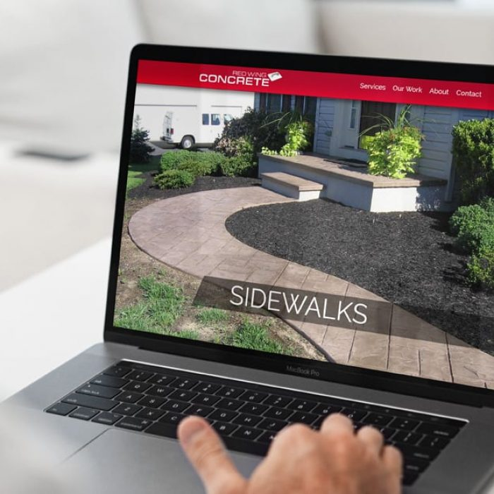 Small business website design on a mobile laptop.